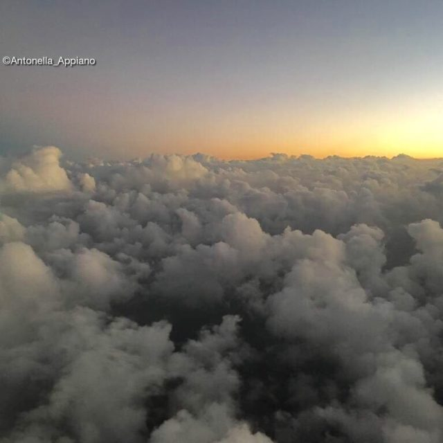 Sunset and a sea of clouds Flying from Bahrein tohellip